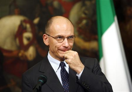 Italian Prime Minister Enrico Letta gestures during a news conference with European Parliament President Martin Schulz (not pictured) at Chigi palace in Rome May 10, 2013. REUTERS/Tony Gentile