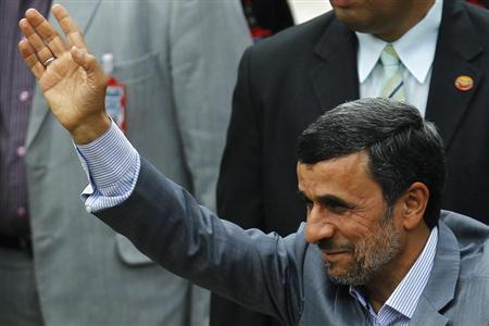 Iran's President Mahmoud Ahmadinejad waves to supporters during a ceremony to swear Venezuela's President Nicolas Maduro (not pictured) into office, in Caracas April 19, 2013. REUTERS/Carlos Garcia Rawlins