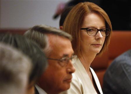 Australian Prime Minister Julia Gillard (R) looks towards Treasurer Wayne Swan during a meeting at Parliament House in Canberra May 13, 2013. REUTERS/David Gray