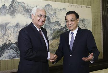 China's Premier Li Keqiang (R) shakes hands with India's Foreign Minister Salman Khurshid during a meeting at the Zhongnanhai Leadership Compound in Beijing May 10, 2013. REUTERS/China Daily