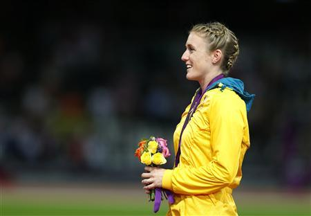 Australia's Sally Pearson stands on the podium after being presented with the gold medal for the women's 100m hurdles at the London 2012 Olympic Games in London at the Olympic Stadium August 8, 2012. REUTERS/Eddie Keogh
