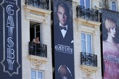 Posters for the film 'The Great Gatsby' showing actor Leonardo DiCaprio (C) and actress Carey Mulligan (R) are displayed outside the Carlton Hotel before the start of the 66th Cannes Film Festival in Cannes May 13, 2013. REUTERS/Regis Duvignau
