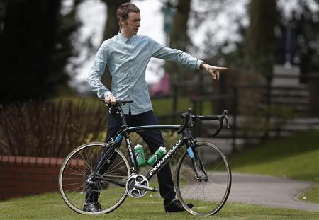 British cyclist Bradley Wiggins poses for photographers during a press day for the Giro d'Italia cycle race at the Kilhey Court hotel in Standish, northern England April 29, 2013. REUTERS/Phil Noble