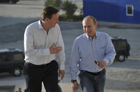 Russian President Vladimir Putin (R) speaks with British Prime Minister David Cameron during their visit to venues for the upcoming 2014 Winter Olympics in Sochi May 10, 2013. REUTERS/Alexei Nikolsky/RIA Novosti/Pool
