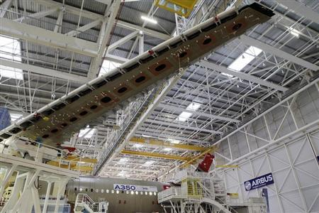 A wing and main body section of the first Airbus A350 is seen on the final assembly line in Toulouse, southwestern France, October 23,2012. REUTERS/Jean-Philippe Arles