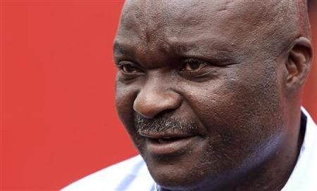 Former Cameroon soccer player Roger Milla attends a news conference during his meeting with young Kenyan players in the capital Nairobi, May 10, 2010 file photo. REUTERS/Noor Khamis