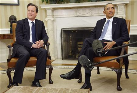 U.S. President Barack Obama (R) welcomes Britain's Prime Minister David Cameron at the Oval Office at the White House in Washington, May 13, 2013. REUTERS/Jonathan Ernst