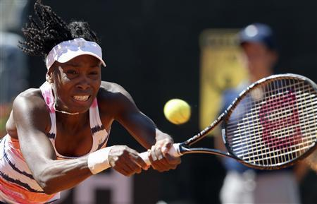 Venus Williams of the U.S. hits a return to Laura Robson of Britain during their women's singles match at the Rome Masters tennis tournament May 13, 2013. Robson won the match 6-3 6-2. REUTERS/Alessandro Bianchi