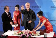 Canadian film director James Cameron shows his palm after making a handprint following a seminar on 3D technology and film cooperation during the second Beijing International Film Festival at the China National Film Museum in Beijing April 24, 2012. REUTERS/China Daily