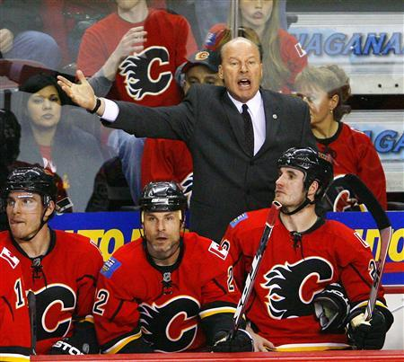 Calgary Flames coach Mike Keenan yells at the referee during the third period of Game 3 in their NHL Western Conference quarterfinal hockey game against the Chicago Blackhawks in Calgary, Alberta April 20, 2009. REUTERS/Todd Korol