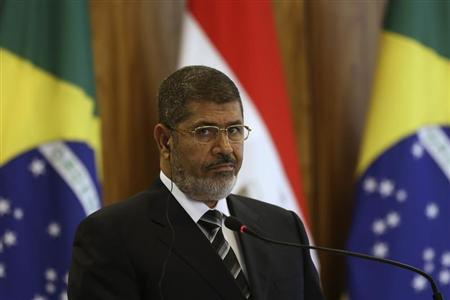 Egypt's President Mohamed Mursi attends a signing ceremony with Brazil's President Dilma Rousseff at the Planalto Palace, May 8, 2013. REUTERS/Ueslei Marcelino