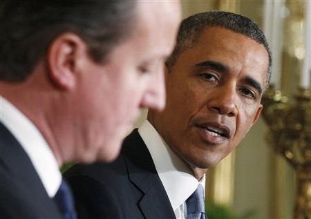 U.S. President Barack Obama (R) looks toward Britain's Prime Minister David Cameron (L) during a joint news conference in the East Room of the White House in Washington, May 13, 2013. REUTERS/Jim Bourg