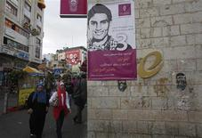 A banner depicting Mohammed Assaf, a contestant in the TV talent show 'Arab Idol', is seen on a building in the West Bank city of Ramallah May 13, 2013. The fractious factions in the Gaza Strip and across the Israeli-occupied Palestinian territories have found one voice to unite behind - the 22-year-old youth, Mohammed Assaf, from Gaza singing songs about a lost homeland on the Middle East's version of 'American Idol'. REUTERS/Mohamad Torokman