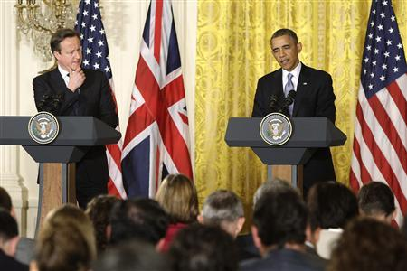 Britain's Prime Minister David Cameron (L) listens as U.S. President Barack Obama (R) responds to a question during a joint news conference in the East Room at the White House in Washington, May 13, 2013. REUTERS/Jonathan Ernst