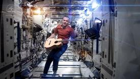 "Canadian astronaut and International Space Station (ISS) Commander Chris Hadfield performs his zero-gravity version of David Bowie's hit ""Space Oddity"" in this image taken from video, courtesy of Chris Hadfield, NASA and CSA. The video, with its familiar refrain ""Ground Control to Major Tom,"" had more than 1.5 million hits on YouTube early afternoon on May 13, 2013, and was being touted as the first music video ever filmed in space. REUTERS/Chris Hadfield, NASA and CSA/Handout via Reuters"