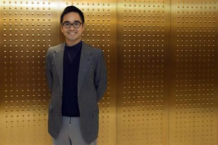 Hong Kong billionaire Adrian Cheng, the 33-year-old grandson of Hong Kong tycoon Cheng Yu-teng, poses for a photograph before an interview with Reuters at his office in Hong Kong April 11, 2013. REUTERS/Tyrone Siu