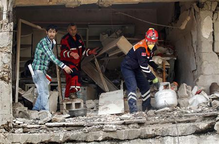 Search and rescue officers work at a damaged building at the site of blast in the town of Reyhanli in Hatay province, near the Turkish-Syrian border, May 13, 2013. REUTERS/Umit Bektas