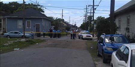 New Orleans Police Department members are seen at the site of a shooting of at least 12 people during a Mother's Day parade in New Orleans, Louisiana, May 12, 2013, as pictured in this photo provided by Fox 8 News. At least 12 people were shot at the parade in New Orleans, with one victim as young as 10 years old, WWLTV reported, citing police Superintendent Ronal Serpas. REUTERS/Fox 8 News/Handout via Reuters
