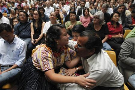 People react after former Guatemalan dictator Efrain Rios Montt was sentenced for genocide charges in the Supreme Court of Guatemala City May 10, 2013. REUTERS/Jorge Dan Lopez