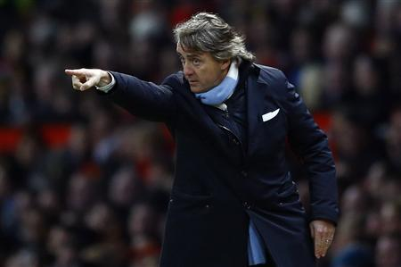 Manchester City's coach Roberto Mancini gestures during their English Premier League soccer match against Manchester United in Manchester, northern England, in this April 8, 2013 file photo. REUTERS/Darren Staples/Files