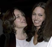 "Actress Angelina Jolie (R) and her mother Marcheline Bertrand pose together at the premiere of Jolie's film ""Original Sin"" in Hollywood in this July 31, 2001 file photo. REUTERS/Fred Prouser/Files"