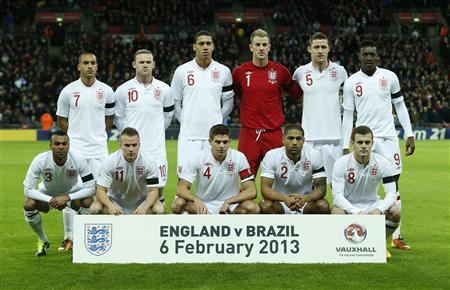 The England team pose for a photograph before their international friendly soccer match against Brazil at Wembley stadium in London February 6, 2013. REUTERS/Eddie Keogh