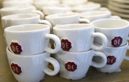 Cups are seen at a Douwe Egberts coffeeshop in Amsterdam, April 12, 2013. REUTERS/Toussaint Kluiters/United Photos