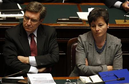 New Minister for Labour and Welfare is Enrico Giovannini (L) sits next to Ministry of Education, Universities and Research Maria Chiara Carrozza at the Lower house of the parliament in Rome, April 29, 2013. REUTERS/Alessandro Bianchi
