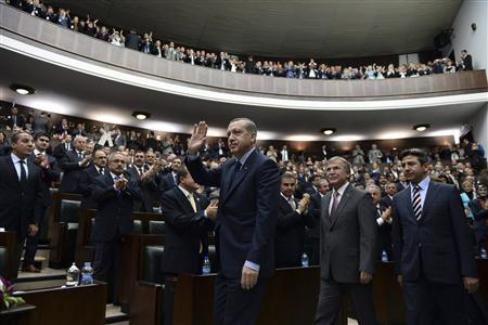 Turkey's Prime Minister Tayyip Erdogan (C) greets members of parliament from his ruling AK Party (AKP) during a meeting at the Turkish parliament in Ankara May 14, 2013. REUTERS/Stringer