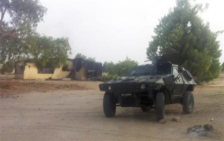 A military vehicle is seen in front of a burnt house in Bama, Maiduguri, Borno State, Nigeria. REUTERS/Stringer