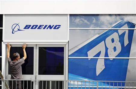 A worker prepares the Boeing chalet ahead of the Farnborough Airshow 2012 in southern England July 8, 2012. REUTERS/Luke MacGregor/Files