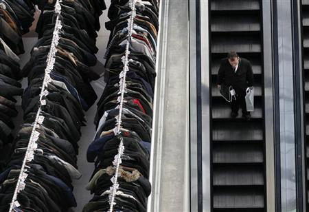A man takes an escalator down inside the National Retail Federation Annual Convention and Expo in New York January 11, 2010. REUTERS/Shannon Stapleton