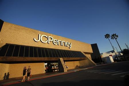 A couple walks by a J.C. Penney store in Arcadia, California March 1, 2013. REUTERS/Mario Anzuoni