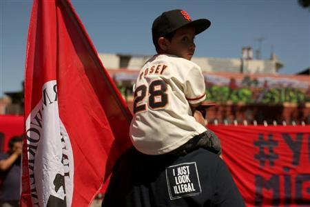 Dominic Ibarra sits on the shoulders of his grandfather Luis Ibarra during an immigration rally on May Day in the Mission District in San Francisco, California May 1, 2013. REUTERS/Robert Galbraith