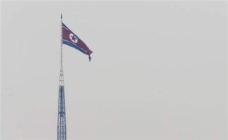 A North Korean flag flutters on top of a tower at the propaganda village of Gijungdong in North Korea, in this picture taken near the truce village of Panmunjom, just south of the demilitarized zone dividing the two Koreas, in Paju, about 55 km (34 miles) north of Seoul April 23, 2013. REUTERS/Lee Jae-Won