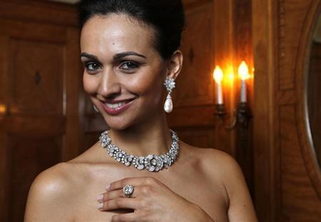 A model wears a diamond necklace/bracelet by Bulgari (1954) a natural pearl and diamond pendant earrings(1962) and a diamond ring (1962) during an auction preview at Sotheby's in Geneva May 7, 2013. REUTERS/Denis Balibouse