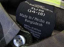 The clothing tag on a boy's shirt by Wal-Mart's brand Faded Glory, which is made in Bangladesh, is shown after purchase from a Walmart store in Encinitas, California, May 14, 2013. REUTERS/Mike Blake