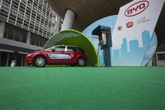 A BYD E6 electric car, which will be used as a taxi, is seen plugged into a charging unit during a launch ceremony for the line of vehicles in Hong Kong, May 15, 2013. REUTERS/Tyrone Siu
