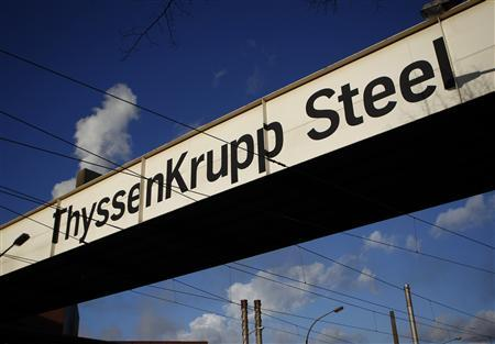 A sign belonging to Europe's largest steel factory of Germany's industrial conglomerate ThyssenKrupp AG is seen in the western German city of Duisburg in this December 6, 2012 file photograph. REUTERS/Ina Fassbender/Files