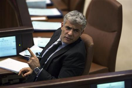 Israel's Finance Minister Yair Lapid gestures as he attends the opening of the summer session of the Knesset, the Israeli parliament, in Jerusalem April 22, 2013. REUTERS/Baz Ratner