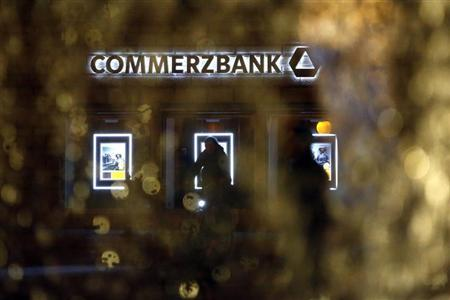 The logo of Germany's Commerzbank is pictured behind a fountain in Frankfurt May 10, 2013. Picture taken May 10, 2013. REUTERS/Lisi Niesner