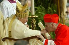 Scottish Cardinal Keith Michael Patrick O'Brien kisses Pope John Paul II's hand during the consistory in Saint Peter's Square at the Vatican October 21, 2003. REUTERS/Alessandro Bianchi