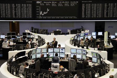 Traders work at their screens in front of the DAX board at the Frankfurt stock exchange May 7, 2013. REUTERS-Remote-Lizza David