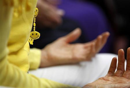 A smiley face piece of jewelery worn by Dr. Funshine, aka Caroline Meeks, M.D. is seen as teaches a laughter therapy class to a group of seniors at the Clairmont Friendship Center in San Diego, California November 17, 2010. REUTERS/Mike Blake