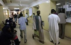 Sudanese migrants wait to get their visas at The Secretariat for Sudanese Working Abroad in Khartoum, May 13, 2013. REUTERS/Mohamed Nureldin Abdallah