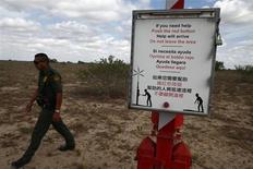 A U.S. Border Patrol agent walks past a rescue beacon near Falfurrias, Texas March 29, 2013. REUTERS/Eric Thayer