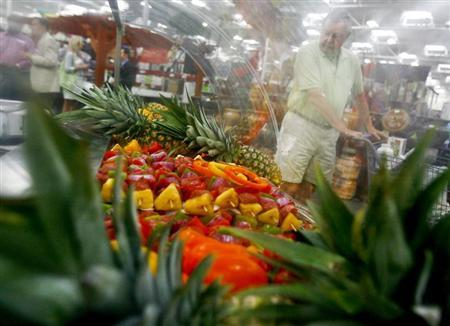 A customer shops along the fruits department in a Sam's Club store, a division of Wal-Mart Stores, in Bentonville, Arkansas June 2, 2011. REUTERS/Sarah Conard