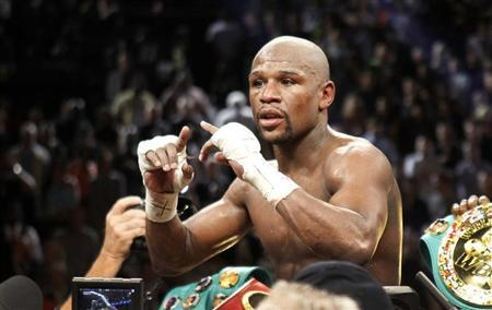 Undefeated WBC welterweight champion Floyd Mayweather Jr. of the U.S. celebrates his victory over Robert Guerrero, also of the U.S., at the MGM Grand Garden Arena in Las Vegas, Nevada May 4, 2013. REUTERS/Steve Marcus