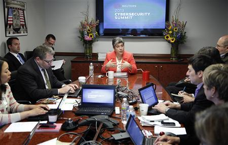 U.S. Homeland Security Secretary Janet Napolitano (C) addresses reporters during the Reuters Cybersecurity Summit in Washington, May 14, 2013. REUTERS/Jonathan Ernst
