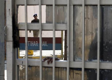 A policeman walks inside the Tihar Jail in New Delhi March 11, 2013. REUTERS/Mansi Thapliyal/Files